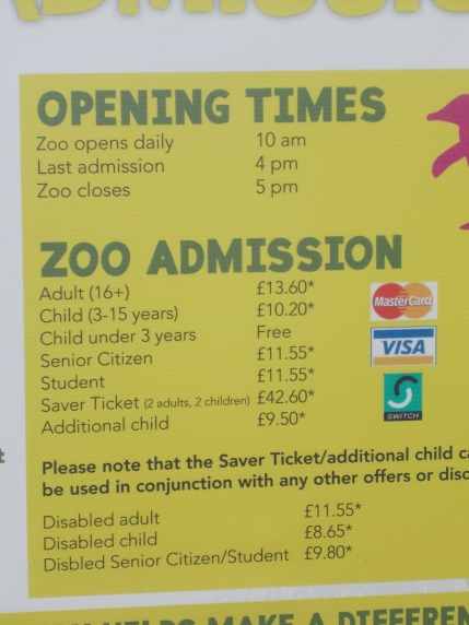 Photo of the price board outside the zoo. Adult admission shows as £13.60 and disabled child admission £8.65