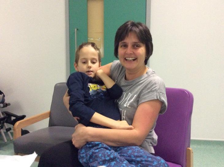 Post-surgery cuddle with Mummy