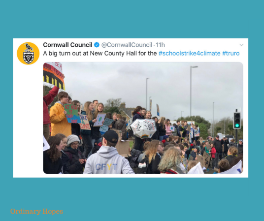 "Children holding placards, demonstrating at Cornwall Council office to raise awareness of climate change. Taken from a Tweet by Cornwall Council, with the text "" A big turn out at New County Hall for the #SchoolStrike4Climate #Truro"